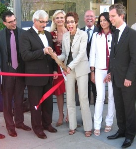 West Hollywood Mayor Abbe Land cutting the ribbon with the Petrossians, the Martinons and Sophie Gayot