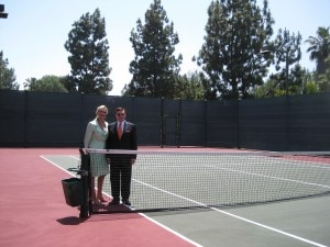 Alberto del Hoyo, General Manager of The Beverly Hills Hotel showing Sophie Gayot the tennis courts before they disappear