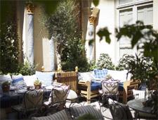 The romantic courtyard patio of Ralph's in Paris