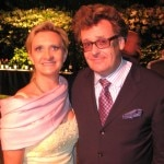 Actor/comedian Greg Proops acting as auctioneer, with Sophie Gayot