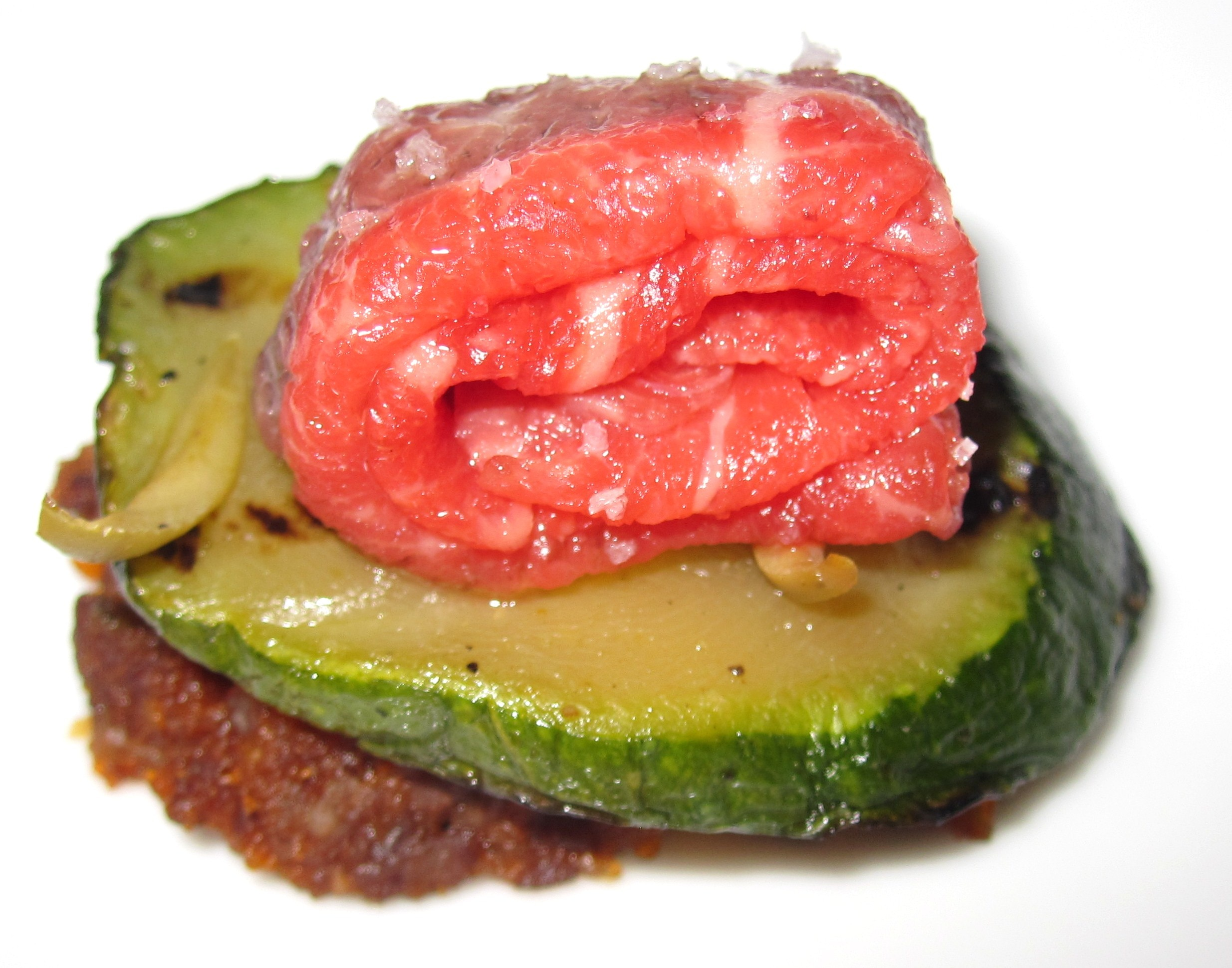 Bolognaise with grilled zucchini, beef carpaccio and black olive