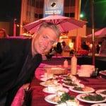 Master of Ceremonies Frank Mottek from KNX Business Hour over M Café table