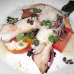 Grilled squid with heirloom tomato salad, black rice, yuzu red onions, umami broth and seaweed tartare