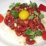 Raw Waygu beef with dried miso, sōmen noodle, peanut vinaigrette, candied watermelon and mint