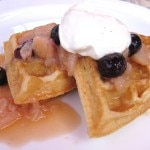 Gluten-free waffle with white nectarine & blueberry compote, and Grand Marnier Chantilly cream