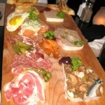 King platter: cured meat and sausage selection with cornichons and pickled onions