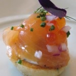 House smoked and sturgeon with lemon herb blinis, dill crème fraîche, chives, sweet onions and salmon pearls