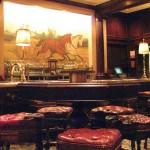 The clubby dark-wooded bar