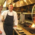 Executive chef Sven Mede with Sophie Gayot by the rotisserie