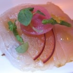 Yellowtail sashimi with fermented black garlic, pluots and shiso