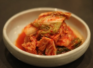 Kimchi, a brined cabbage and turnip dish, is an ubiquitous part of Korean cuisine