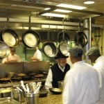Chef Paul Prudhomme and crew hard at work behind the scenes at K-Paul's Louisiana Kitchen