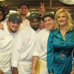 Chef Paul Prudhomme and his talented kitchen staff with Sophie Gayot