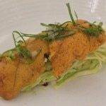 Sea urchin on apple cabbage as it comes to the table