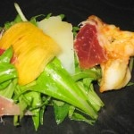 Spanish salad with mizuna lettuce, serrano ham, manchengo, garlic prawns and persimmons with sherry vinaigrette