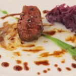 Roasted venison loin with red cabbage ginger-lychee compote, sweet potato and snap peas