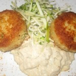 Crab cakes with rémoulade, frisée and herb salad