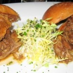 Duck confit sliders with orange gastrique and frisée salad