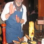 Partner/owner Norbert Wabnig of The Cheese Store of Beverly Hills preparing raclette