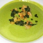 Sweet pea soup with walnut pesto croutons