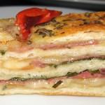 Stromboli bread stuffed with salami, smoked mozzarella, basil and garlic