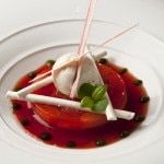 Rhubarb terrine with a strawberry consommé, meringue and ice cream