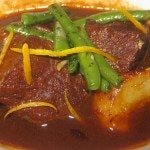Braised beef short ribs with white wine and orange zest, served with haricots verts and fingerling potatoes