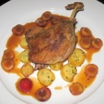Confit de canard à l'orange: duck leg with cherries and Sarladaise potatoes
