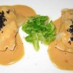 Langoustine ravioli with green cabbage, truffles, foie gras sauce