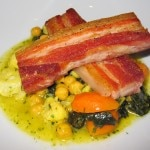 Sautéed pork belly with chickpeas, cavolo nero, cauliflower, saffron and orange