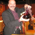 General manager Joel Hoachuck pouring 2009 Giana Zinfandel from Chiarello Family Vineyards