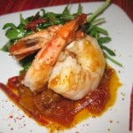 Sautéed shrimp and chorizo with citrus piperade mesclun salad