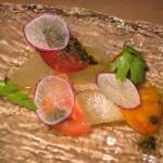 Heirloom melon and onion salad: tomato, hazelnuts and basil