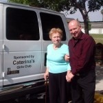 Caterina Serato with one of the vans from Caterina's Club to transport the children
