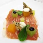Iberico ham: Tuscan melons, manchego, soy-balsamic gel, sour olive oil, black sesame