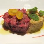 Tuna tartar with a blood orange vinaigrette, artichoke purée, haricots verts and celery