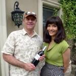 Alain Gayot receives a bottle of Mt. Brave 2008 Cabernet Sauvignon from Julia Jackson
