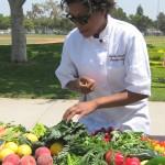 Nyesha Arrington selecting her produce