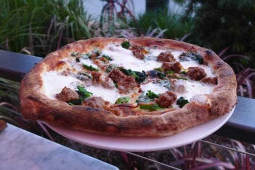 Sausage & rapini pizza