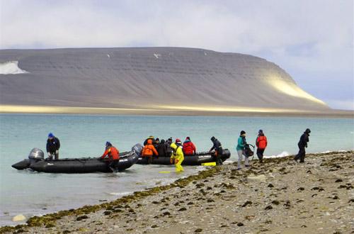 Zodiacs landing on stark tundra