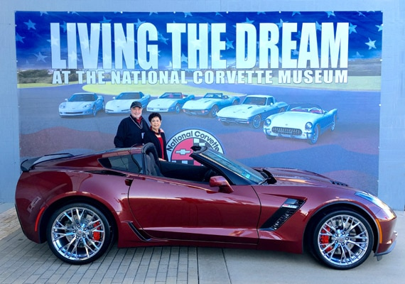 Mike Bell stands beside his brand-new 2016 Chevrolet Corvette Z06 in Long Beach Red, with his wife, Malea