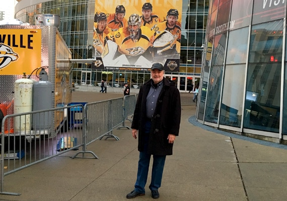 Mike Bell attends a Nashville Predators hockey game at the Bridgestone Area