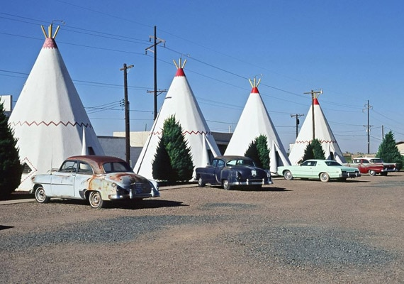 A row of wigwams and classic cars