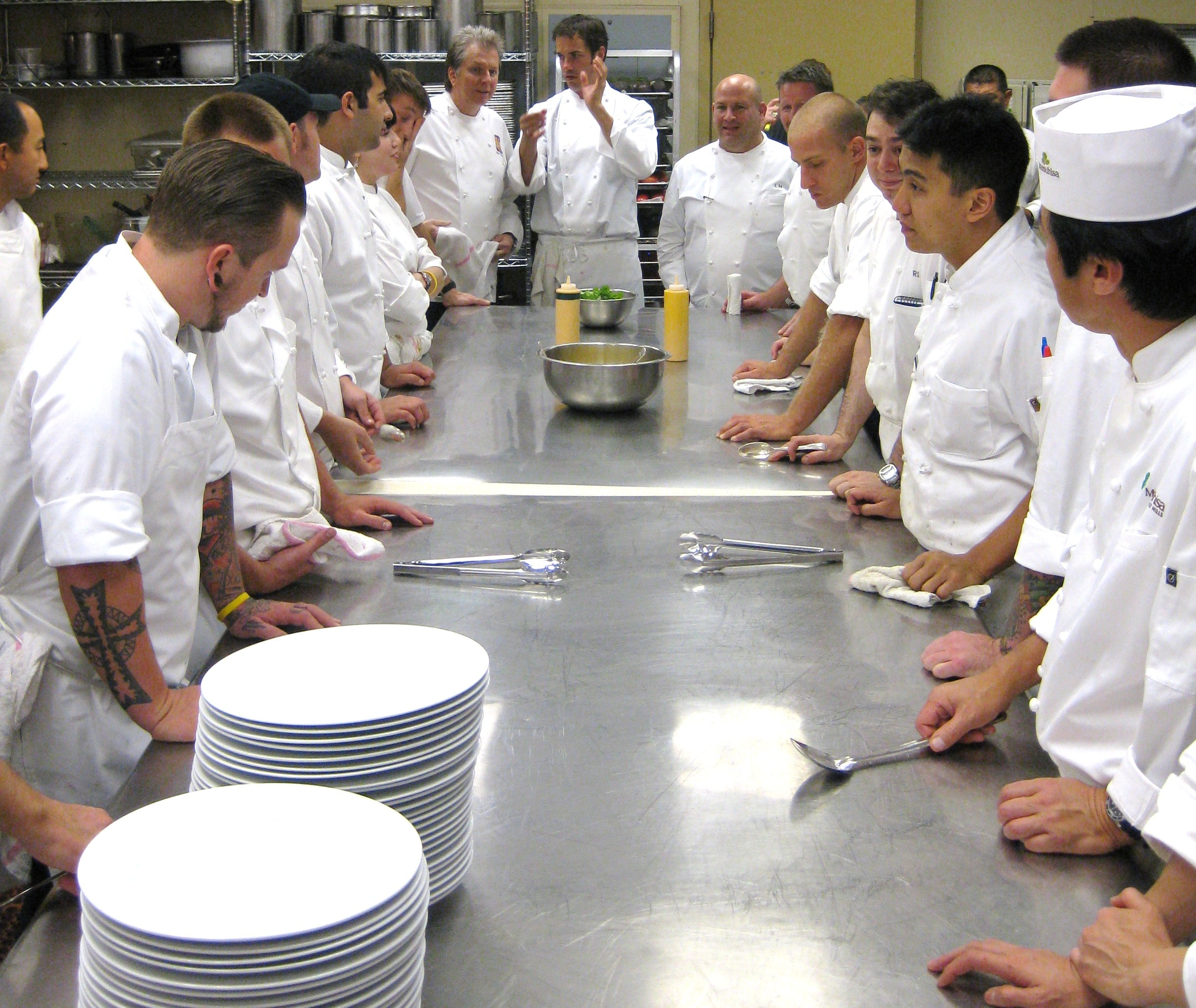 Chefs in the kitchen of Spago Beverly Hills waiting for the next course to plate