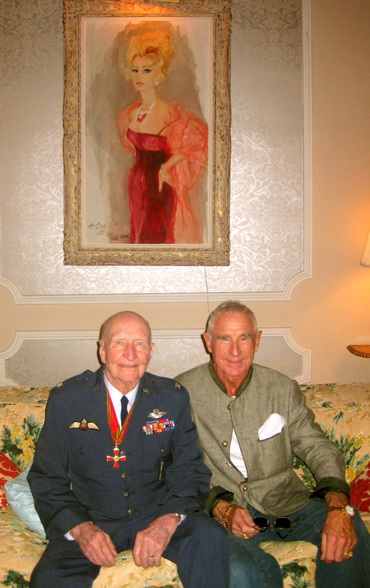 Colonel Gail Halvorsen with Prince Frederic von Anhalt under a portrait of Zsa Zsa Gabor