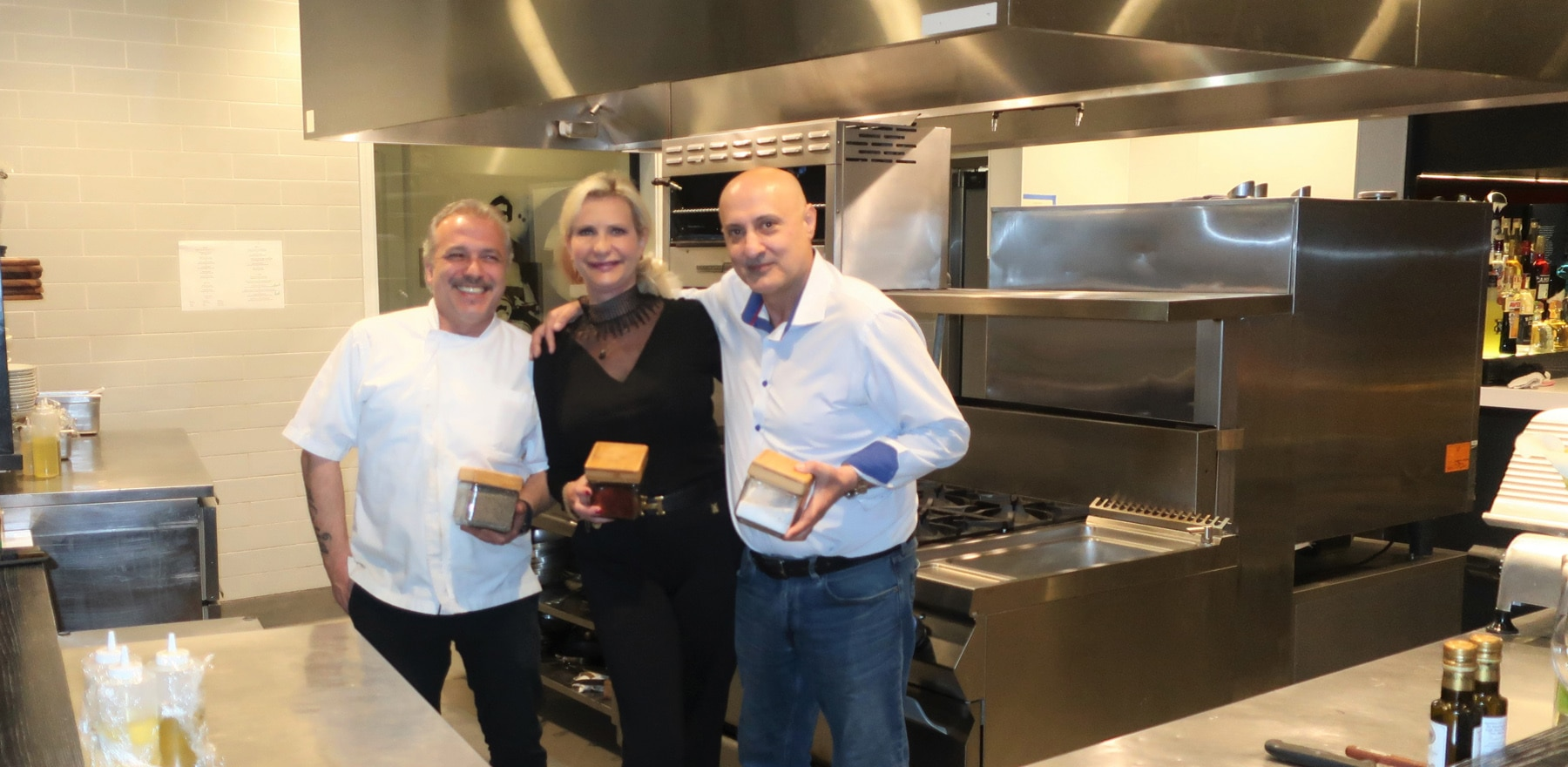 Chef Emidio Tidu, restaurateur Stelian Tasu in the kitchen with Sophie Gayot