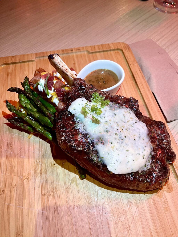 20 oz. bone-In ribeye steak, crispy mashed potatoes, asparagus, peppercorn sauce