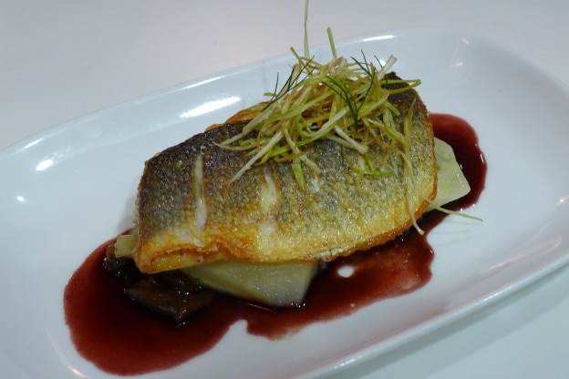 Loup de mer served with caramelized onion, fennel and red wine reduction